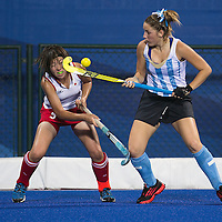 Kimika Hoshi (L) of Japan fight for the ball with Micaela Retegui (R) of Argentina in the Hockey 5s Women's Bronze Medal Match at Nanjing Olympic Sports Center Gymnasium during the Nanjing 2014  Youth Olympic Games in Nanjing, China 26 August 2014. The Nanjing Youth Olympic  Games 2014 runs from from 16 to 28 August  2014.