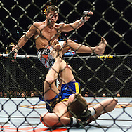"NEWCASTLE, ENGLAND, UNITED KINGDOM, JANUARY 19 2008: Sam Stout (facing) throws a kick towards a downed Per Eklund during ""UFC 80: Rapid Fire"" inside the Metro Radio Arena in Newcastle, England on January 19, 2008."