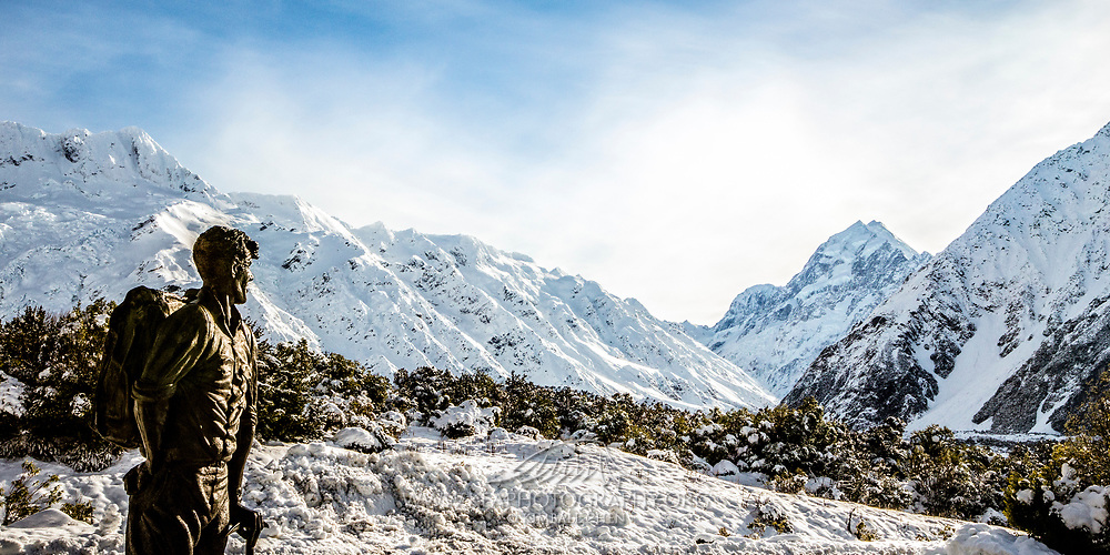 Outside the Sir Edmund Hillary Alpine Centre, a statue of mountaineer Sir Edmund gazes towards the snow-blanketed Mt Cook range.