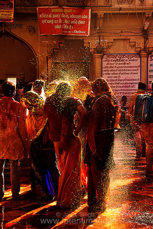 Splash of water color on people during Holi at Barsana, Mathura. Braj ki Holi