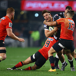 DURBAN, SOUTH AFRICA - JULY 15: Derek Carpenter of the Sunwolves looks to tackle Andre Esterhuizen of the Cell C Sharks during the Super Rugby match between the Cell C Sharks and Sunwolves at Growthpoint Kings Park on July 15, 2016 in Durban, South Africa. (Photo by Steve Haag/Gallo Images)