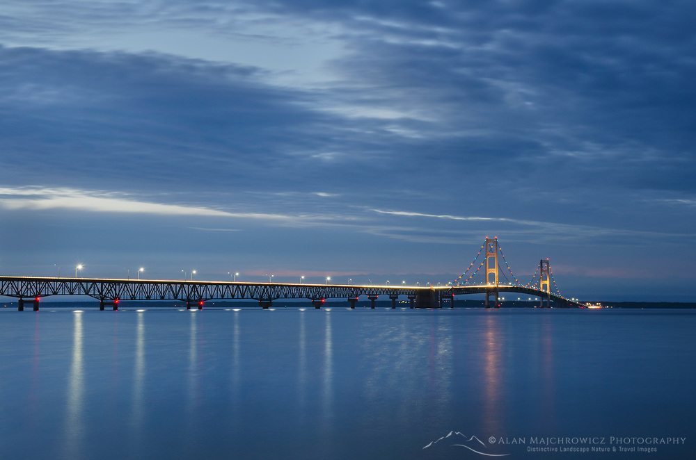 Long exposure showing lights on Mackinac Bridge at twilight, seen from Mackinaw City Michigan.