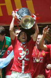 MOSCOW, RUSSIA - Wednesday, May 21, 2008: Manchester United's Carlos Tevez lifts the European Cup after beating Chelsea on sudden death penalties during the UEFA Champions League Final against Chelsea at the Luzhniki Stadium. (Photo by David Rawcliffe/Propaganda)