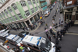 "© Licensed to London News Pictures . 11/06/2013 . London , UK . Police cordon off the road . Police surround a former police station on 40 Beak Street , Soho this morning (11th June) which has been occupied by organisers as a base for today's "" Stop G8 "" anti capitalist protest . Demonstrations in London today (Tuesday 11th June 2013) ahead of Britain hosting the 39th G8 summit on 17th/18th June at the Lough Erne Resort , County Fermanagh , Northern Ireland , next week . Photo credit : Joel Goodman/LNP"
