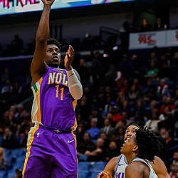 Jan 30, 2018; New Orleans, LA, USA; New Orleans Pelicans guard Jrue Holiday (11) shoots over Sacramento Kings guard De'Aaron Fox (5) during the fourth quarter at the Smoothie King Center. The Kings defeated the Pelicans 114-103. Mandatory Credit: Derick E. Hingle-USA TODAY Sports