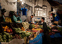 CASABLANCA, MOROCCO - CIRCA APRIL 2018: Vegetable seller and buyer in the Medina of Casablanca.