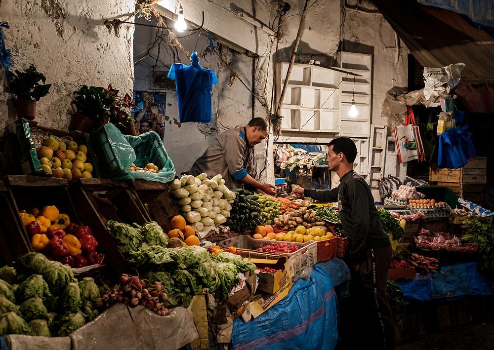 CASABLANCA, MOROCCO - CIRCA APRIL 2018: Vegetable seller and buyer in the Medina of Casablanca.