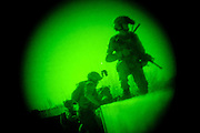 """American soldiers from the 1/320th Field Artillery Regiment conduct a nighttime """"small kill team"""" operation near Combat Outpost Nolen in the Arghandab District of Kandahar Province."""