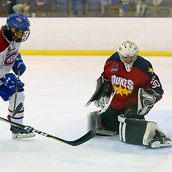 KINGSTON, ON  - FEB 22,  2018: Ontario Junior Hockey League game between the Kingston Voyageurs and the Wellington Dukes. Jonah Capriotti #30 of the Wellington Dukes gets a piece of Andrew Suriyuth #27 of the Kingston Voyageurs shot during the third period.<br /> (Photo by Ian Dixon / OJHL Images)