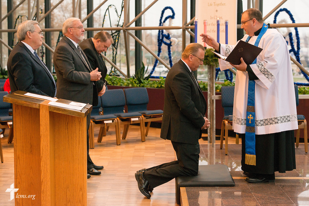 The Rev. Bart Day, interim Chief Mission Officer and executive director in Office of National Mission, installs Mike Fischer during a Service of Installation in the International Center chapel of The Lutheran Church–Missouri Synod on Wednesday, Dec. 10, 2014, in Kirkwood, Mo. LCMS Communications/Erik M. Lunsford