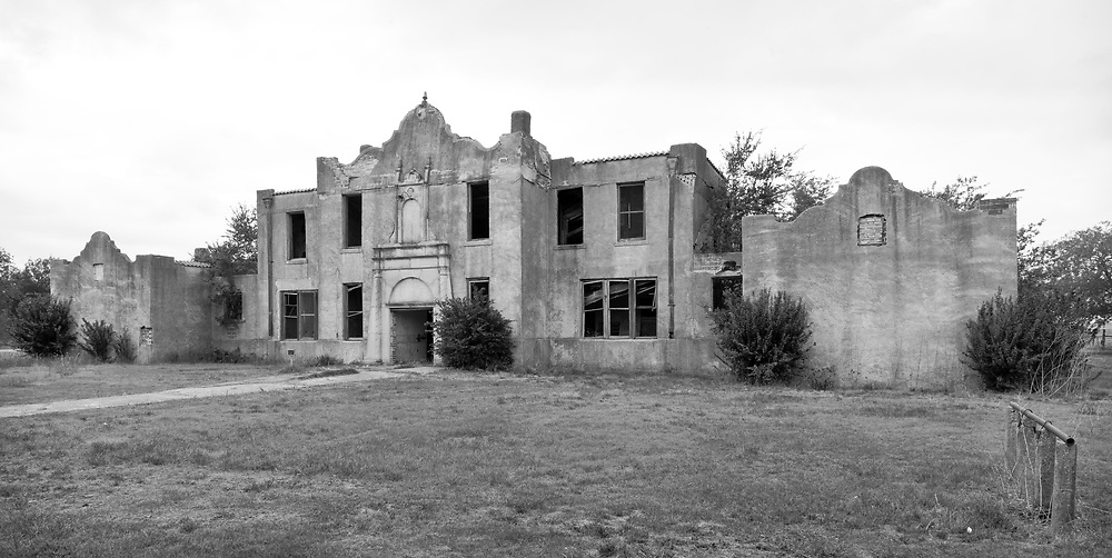 In 1896 Mosheim (formerly Live Oak) had fifty people, a school, and several businesses. From 1941 till the late 1960's, Mosheim reached its zenith with around 200 citizenry. Thereafter the town began to decline. The Mosheim post office closed in 1976.<br /> <br /> The exact date of construction for this schoolhouse has not been identified. It has signs of electricity being added after initial construction. There is a supported rail on the right of the image, possibly for hitching horses.
