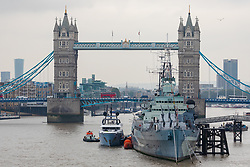 © Licensed to London News Pictures. 16/09/2019. London, UK. Luxury superyacht Ocean Dreamwalker III moors next to HMS Belfast in front of Tower Bridge on the River Thames, seen with a helicopter on the helipad at the stern of the yacht during a London visit. 155 feet long long Ocean Dreamwalker III was built in 2018 and is rumoured to be owned by John Deng, a Chinese entrepreneur and politician. It is believed that this is the first time a superyacht has visited the capital with a helicopter onboard. Photo credit: Vickie Flores/LNP