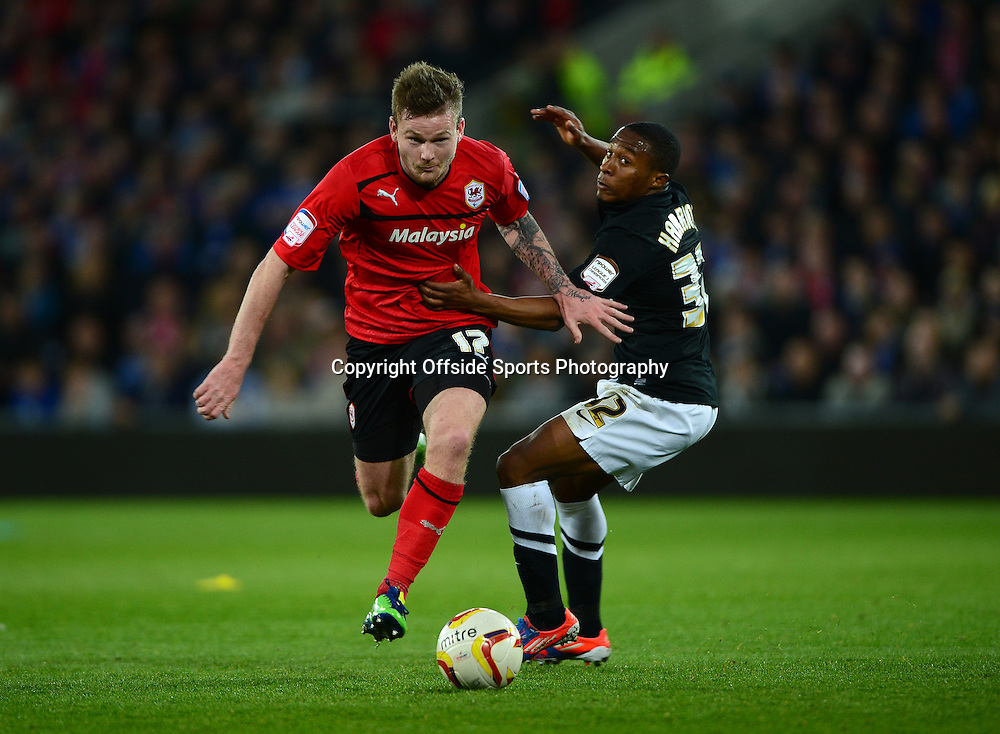 16th April 2013 - Npower Championship  - Cardiff City v Charlton Athletic - Aron Gunnarsson of Cardiff City in action with Callum Harriott of Charlton Athletic - Photo: Marc Atkins / Offside.