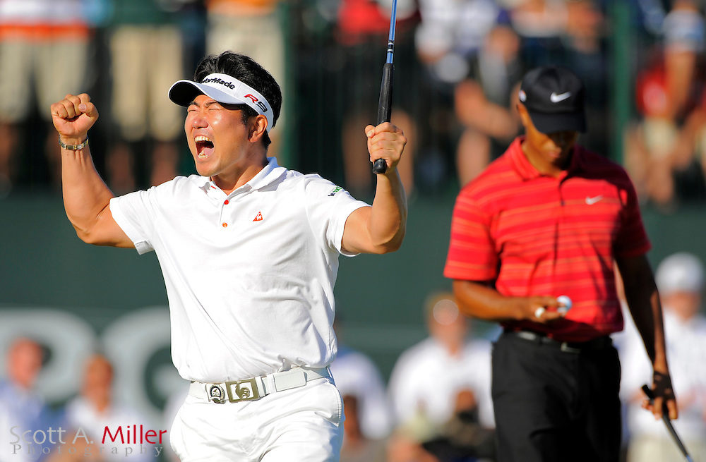 Aug 16, 2009; Chaska, MN, USA; Y.E. Yang (KOR), left, celebrates after making a birdie putt on the 18th green to win the 2009 PGA Championship as Tiger Woods (USA), right, looks down at his ball at Hazeltine National Golf Club.  ©2009 Scott A. Miller