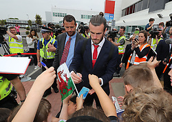 CARDIFF, WALES - Saturday, June 4, 2016: Wales' Gareth Bale and his team sign autographs for Ysgoal Treganna students as the team are given a colourful send off at Cardiff Airport as the squad head to Sweden for their last friendly before the UEFA Euro 2016 in France. (Pic by David Rawcliffe/Propaganda)
