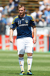 August 21, 2010; Santa Clara, CA, USA;  Los Angeles Galaxy midfielder Chris Birchall (11) warms up before the game against the San Jose Earthquakes at Buck Shaw Stadium. San Jose defeated Los Angeles 1-0.