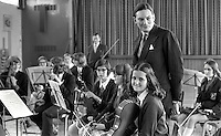 Minister of State Paul Channon meets members of the local school orchestra on a visit to Rathcoole High, Newtownabbey, N Ireland. 197204000199.<br /> <br /> Copyright Image from Victor Patterson, 54 Dorchester Park, Belfast, UK, BT9 6RJ<br /> <br /> t1: +44 28 9066 1296 (from Rep of Ireland 048 9066 1296)<br /> t2: +44 28 9002 2446 (from Rep of Ireland 048 9002 2446)<br /> m: +44 7802 353836<br /> <br /> e1: victorpatterson@me.com<br /> e2: victorpatterson@gmail.com<br /> <br /> The use of any of my copyright images is subject to my Terms & Conditions.<br /> <br /> It is IMPORTANT that you familiarise yourself with them. They are available on my website, victorpatterson.com.<br /> <br /> None of my copyright images may be used on the Internet unless they are visibly watermarked, i.e. © Victor Patterson in the body of the image. Additionally metadata denoting my copyright must NOT be deleted. <br /> <br /> Web use is extra at the current recommended NUJ rates.