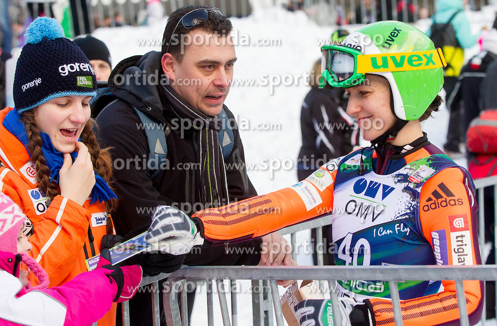 VTIC Maja of Slovenia with fans during 11th Women FIS Ski Jumping World Cup competition in Planica replacing Ljubno  on January 25, 2014 at HS95, Planica, Slovenia. Photo by Vid Ponikvar / Sportida