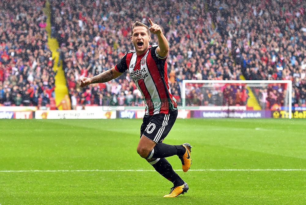 Sheffield United's Billy Sharp celebrates scoring his team's opening goal