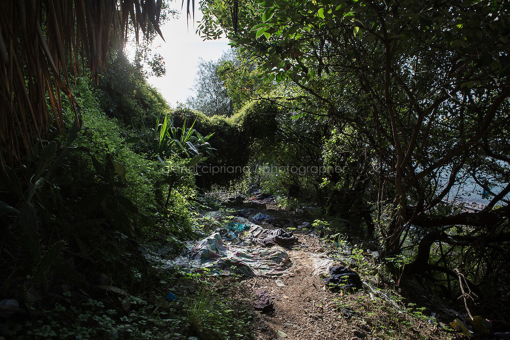VENTIMIGLIA, ITALY - 20 NOVEMBER 2014: Clothes and blankets  left by a migrant a trail near the Italian-French border  in Ventimiglia, Italy, on November 20th 2014.<br /> <br /> The Ventimiglia-Menton border is the border between Italy and France crossed by migrants who decide to continue their journey up north towards countries such as Germany, Sweden, The Netherlands and the UK where the process to receive the refugee status or humanitarian protection is smoother and faster. in Ventimiglia, Italy, on November 17th 2014.