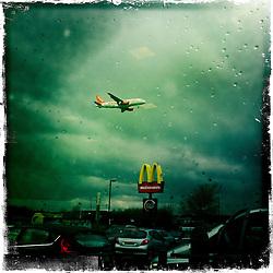 easyjet landing at Edinburgh airport..Hipstamatic images taken on an Apple iPhone..©Michael Schofield.