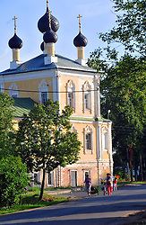 "Women walk past the Voskreseniia church on their way to market in Uglich, Russia. As one of Russia's ""Golden Ring"" cities, Uglich is designated a town of significant cultural importance."