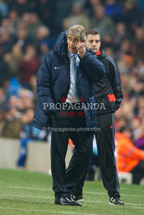 MANCHESTER, ENGLAND - Tuesday, November 5, 2013: Manchester City's manager Manuel Pellegrini during the UEFA Champions League Group D match against CSKA Moscow at the City of Manchester Stadium. (Pic by David Rawcliffe/Propaganda)
