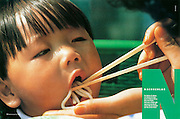 "TEARSHEET: ""Boy in Seoul being fed noodles"" by Heimo Aga, Feinschmecker."