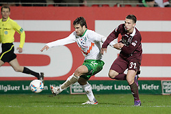 21.01.2012, Petzenberg, Kaiserslautern, GER, 1. FBL, 1.FC Kaiserslautern vs Werder Bremen., 18. Spieltag, im Bild .Jakub SWIERCZOK (1.FC Kaiserslautern) - SOKRATIS (SV Werder Bremen, #22).., EXPA Pictures © 2012, PhotoCredit: EXPA/ Eibner-Pressefoto / Neis ***** ATTENTION OUT OF GERMANY *****