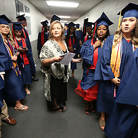 Robyn Taylor, a Nettleton High School History teacher and a class sponsor, calls the graduates names out as she has them line up to walk out for theNettleton High School graduation ceremony Saturday morning at the BancorpSouth Arena in Tupelo.