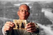 Apr. 07, 2011; Hiroshima, Japan - Shoso Hirai holds up a photo of his family.<br /> Project Hibakusha : Hope for Peace