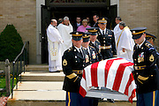 Kevin Jones receives an embrace from a priest at Holy Spirit Church in Gardner as his wife, Elaine watches her son's casket leave the church. Westminster native Ryan Patrick Jones was a First Lieutenant in the Army and lost his life at the age of 23 while serving his country.