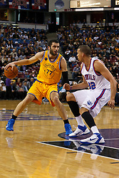 March 14, 2011; Sacramento, CA, USA;  Golden State Warriors small forward Vladimir Radmanovic (77) is defended by Sacramento Kings shooting guard Francisco Garcia (32) during the first quarter at the Power Balance Pavilion.