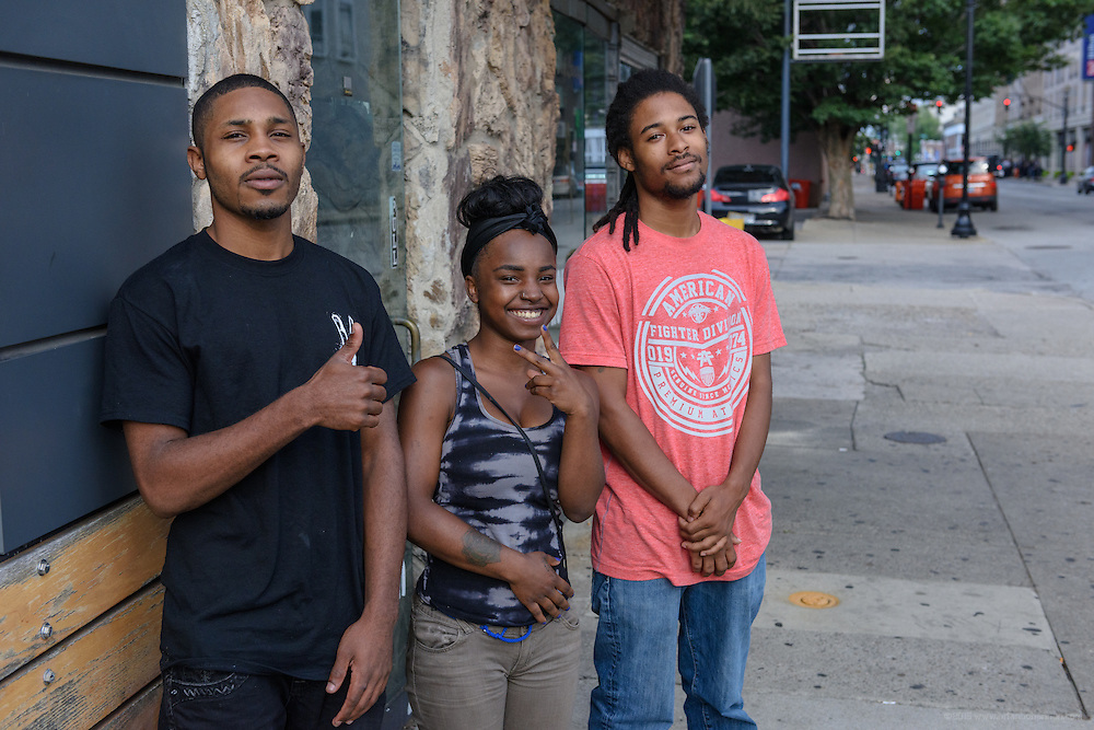 Three kids Eddie Woods was able to save from the streets, Darrin Ware, 22, a former member of YNO, his sister Dashia, 18, and her boyfriend, Joe Carter, pose for a photo after a Sept. 18, 2016 meeting downtown. (Photo by Brian Bohannon)