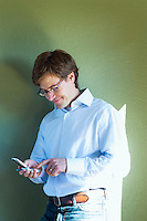 Man text messaging with his mobile phone&#xA;<br />