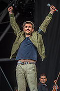 Damon Albarn (wears a black armband in honour of Jo Cox and the Brexit) and makes a passionate pro EU speech before introducing  the Orchestra of Syrian Musicians on the Pyramid Stage - The 2016 Glastonbury Festival, Worthy Farm, Glastonbury.