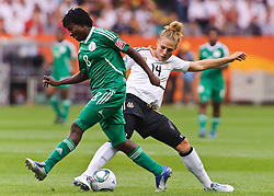 30.06.2011, Commerzbank-Arena, Frankfurt, GER, FIFA Women Worldcup 2011, GRUPPE A, Deutschland (GER) vs. Nigeria (NGR) , im Bild Ebere ORJI (NGA #8,Rivers Angels)  im Zweikampf mit Kim Kulig (Deutschland #14, Hamburg) // during the FIFA Women Worldcup 2011, Pool A, Germany vs. Nigeria on 2011/06/30, Commerzbank-Arena, Frankfurt, Germany. EXPA Pictures © 2011, PhotoCredit: EXPA/ nph/  Roth       ****** out of GER / CRO  / BEL ******