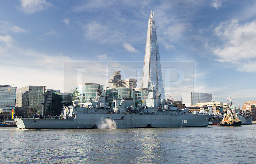 © Licensed to London News Pictures. 27/01/2014. London, UK. The German frigate Schleswig Holstein F216 leaves London passing the Shard after a short visit to the capital. The Brandenburg-class vessel will take part in the Royal Nav's Cougar 14 deployment later this year. Photo credit : Vickie Flores/LNP