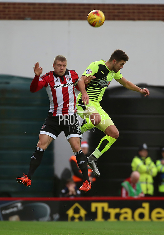 Brentford defender Jake Bidwell challenging for the ball with Huddersfield Town defender Tommy Smith during the Sky Bet Championship match between Brentford and Huddersfield Town at Griffin Park, London, England on 19 December 2015. Photo by Matthew Redman.