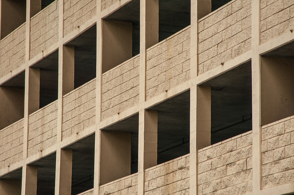 A lot of squares: Sometimes light and shadow  are the drivers in a visual that lead us to or from a point giving us a sense of dimension. Photographed in downtown Honoluu, HI in 2012