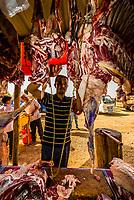 A butcher at work at the Sunday Livestock market just outside Kashgar (China's westernmost city), Xinjiang Province, China. Kashgar is along the Silk Road, near Tajikistan and Pakistan.