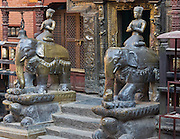 "Sculptures of armored elephants carry Buddhas on turtle bases at Golden Temple (Hiranya Varna, or Suwarna Mahavihara), a Buddhist Monastery existing since 1409 or earlier, located just north of Patan's Durbar Square, in Nepal, Asia. Patan was probably founded by King Veer Deva in 299 AD from a much older settlement. Patan, officially called Lalitpur, the oldest city in the Kathmandu Valley, is separated from Kathmandu and Bhaktapur by rivers. Patan (population 190,000 in 2006) is the fourth largest city of Nepal, after Kathmandu, Biratnagar and Pokhara. The Newar people, the earliest known natives of the Kathmandu Valley, call Patan by the name ""Yala""  (from King Yalamber) in their Nepal Bhasa language. UNESCO honored Patan's Durbar Square (Palace Square) as one of the seven monument zones of Kathmandu Valley on their World Heritage List in 1979. All sites are protected under Nepal's Monuments Preservation Act of 1956."