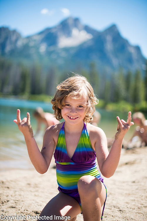 Children playing on the beach at Stanley Lake. Sawtooth National Recreation Area. Model release.