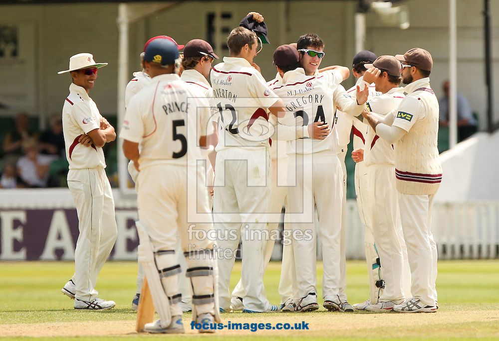 George Dockrell (4th right) of Somerset County Cricket Club celebrates with his team mates after getting Usman Khawaja of Lancashire County Cricket Club out during the LV County Championship Div One match at the County Ground, Taunton, Taunton<br /> Picture by Tom Smith/Focus Images Ltd 07545141164<br /> 02/07/2014