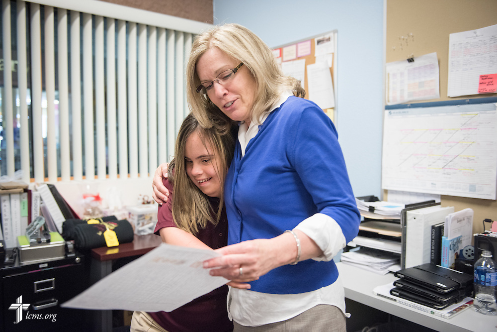 Lee Segalla, director of the Mark 10:14 Program, hugs Mark 10:14 Program student Madison Hinskey after reviewing class work at Faith Lutheran Middle School & High School on Tuesday, May 26, 2015, in Las Vegas, Nev.  LCMS Communications/Erik M. Lunsford