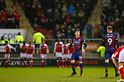 Rotherham United celebrate Rotherham United midfielder Joe Newell (22) goal in the background as Bradford City forward Shay McCartan (14) and Bradford City forward Charlie Wyke (9)  wait to kick off during the EFL Sky Bet League 1 match between Rotherham United and Bradford City at the AESSEAL New York Stadium, Rotherham, England on 23 January 2018. Photo by Simon Davies.