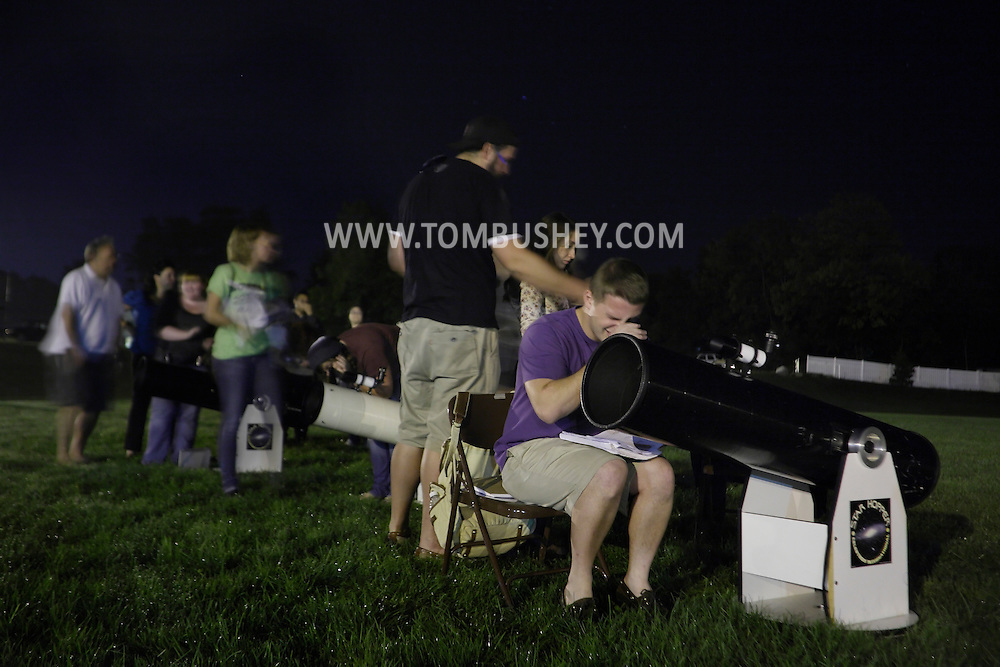 Middletown, New York - Students in an astronomy class look through telescopes at Orange County Community College on Sept. 26, 2011.