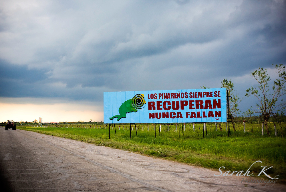 Billboards lining the roads send messages of recovery from Fidel Castro to the people who are waiting for help in the Pinar del Rio area of Cuba, which was devastated by Hurricane Ike and Hurricane Gustav. This sign says that Pinar Del Rio will always be recouperated and never fall.