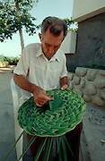 CUBA, GUARDALAVACA..Hat made from palm leaves..(Photo by Heimo Aga)
