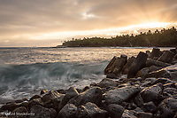 Crashing wave on the shore at Pohoiki, at sunset. Puna district, Big Island of Hawaii.
